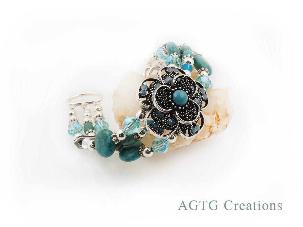 Three strand bracelet with flower